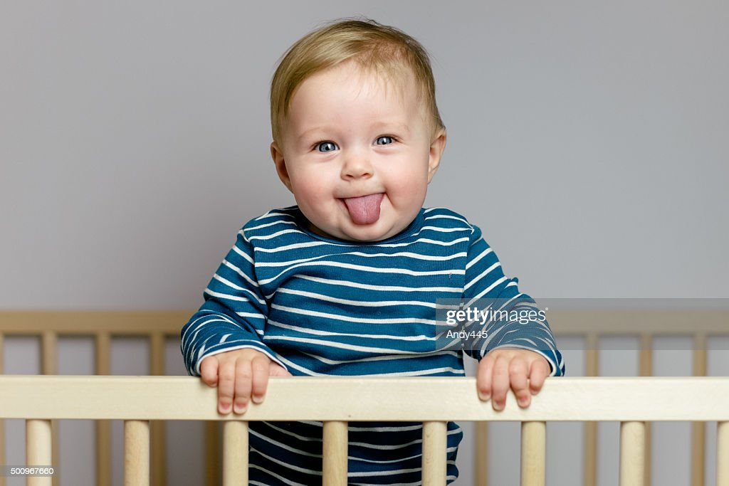 Baby in the crib : Stock Photo