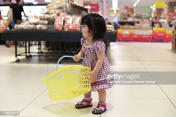 Baby in the supermarket with basket :)
