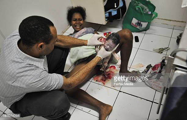 A baby is born on the floor of the labour ward at a hospital on August 14 2009 in Port Moresby Papua New Guinea Since 1996 the number of children...