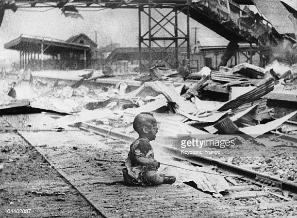 A baby is crying all alone in the middle of the ruins of the Shanghai train station which was bombed by the Japanese during the SinoJapanese War That...