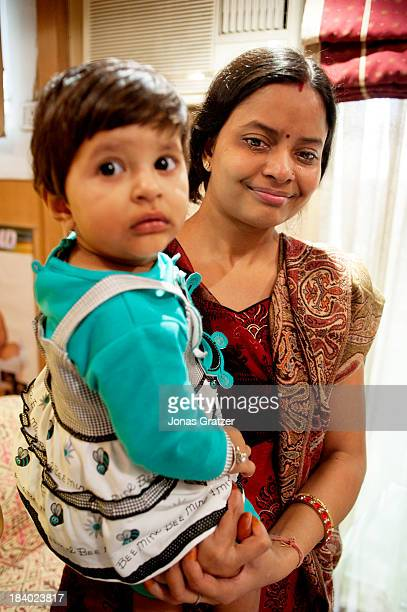 CALLED 'DELHI IVF' NEW DELHI INDIA A baby is held by the surrogate mother who helped to conceive the child Eggs from Europeans semen from wealthy...