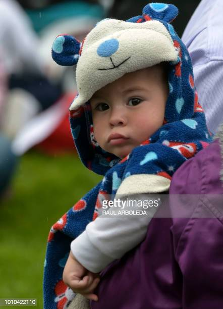A baby is pictured during a public event to promote the benefits of breastfeeding during the World Breastfeeding Week at a park in Bogota on August 3...