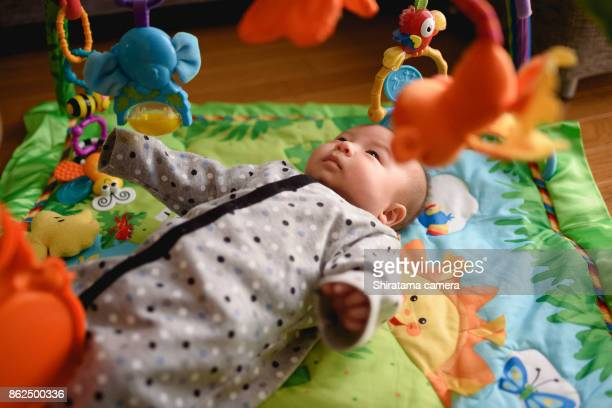 Baby is playing in play-gym