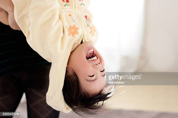 baby is playing up side down - mamigibbs stock photos and pictures