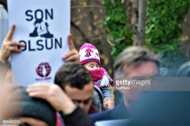 A baby is seen as an organized group of proIslamic demonstrators makes a statement outside the main courthouse on the 21th anniversary of Turkey's...