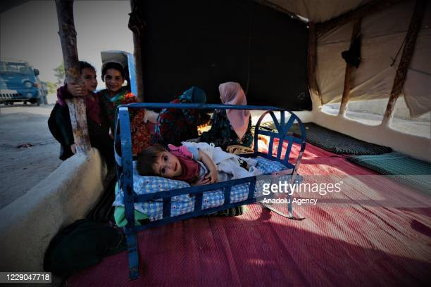 A baby is seen on her crib on the first year of Operation Peace Spring as life turned to normal in Tal Abyad Syria on October 13 2020 A year on after...