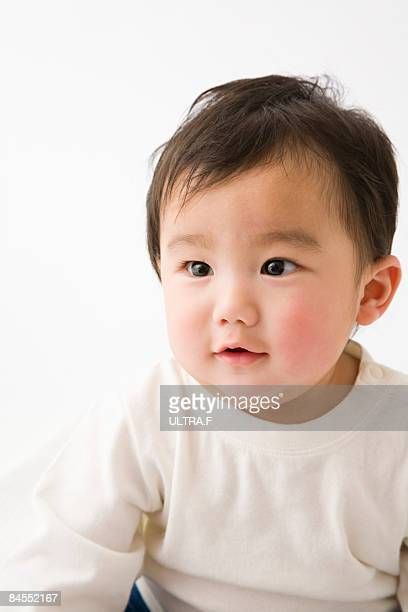 a baby is sitting. - one baby boy only stock pictures, royalty-free photos & images