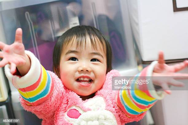 baby is smiling with open arms - mamigibbs stock photos and pictures