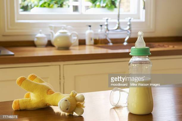 baby items on kitchen counter - baby bottle stock pictures, royalty-free photos & images