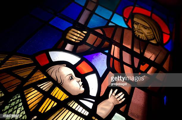 baby jesus in a manger on stained glass - catholic church christmas stock photos and pictures