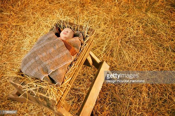 Baby Jesus lying in a manger