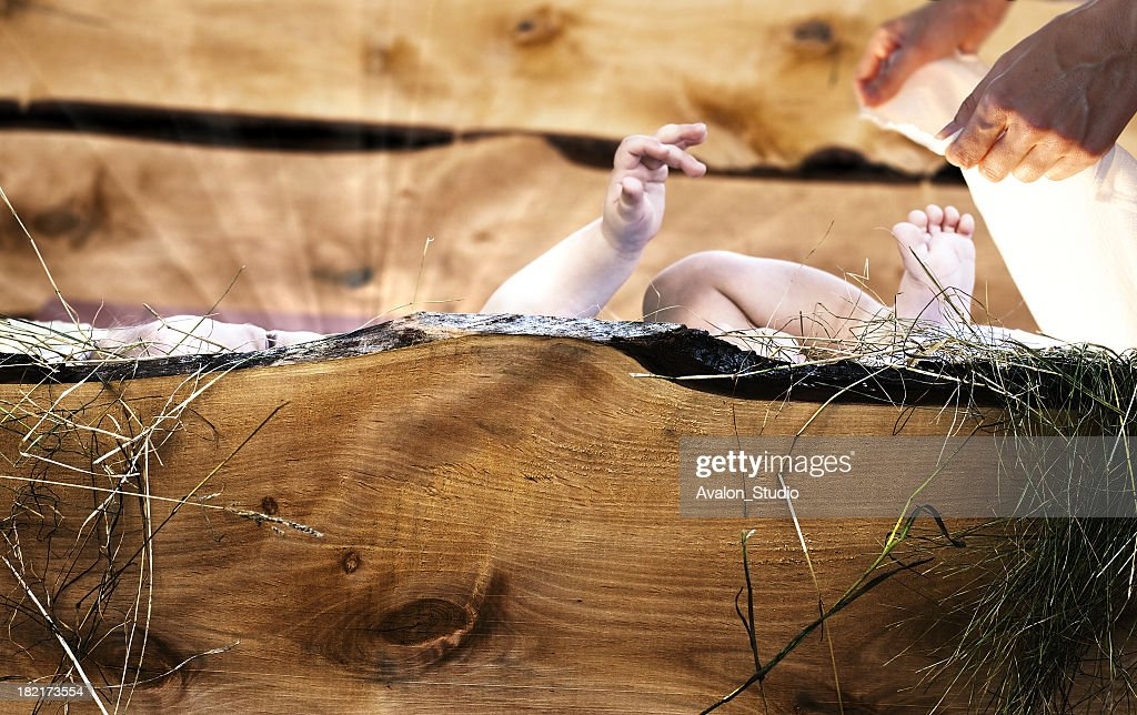 Baby Jesus lying in wooden crib. : Stock Photo