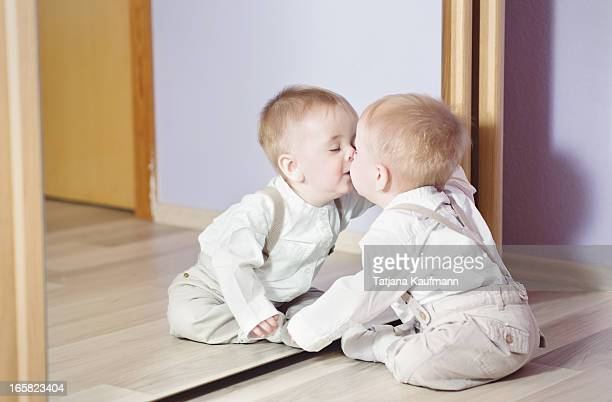 Baby kissing his Reflection in the Mirror