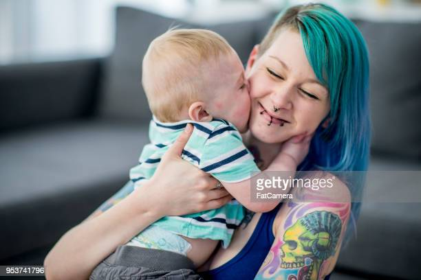 baby kissing mom - hair colour stock pictures, royalty-free photos & images