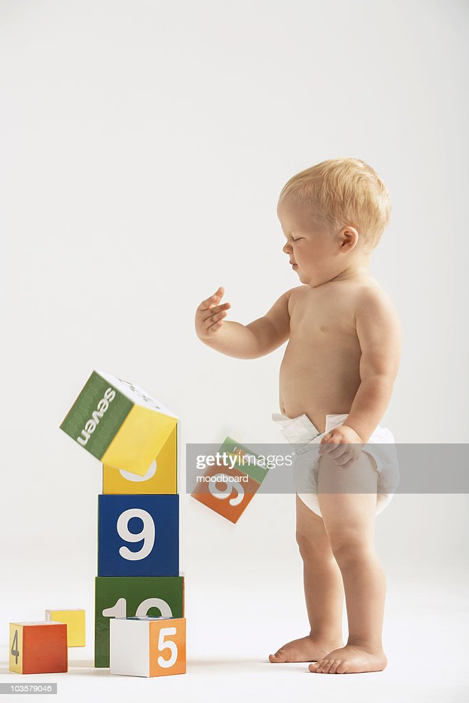 Baby Knocking Over Blocks : Stock Photo