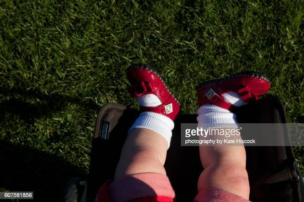 baby legs with red shoes and white socks