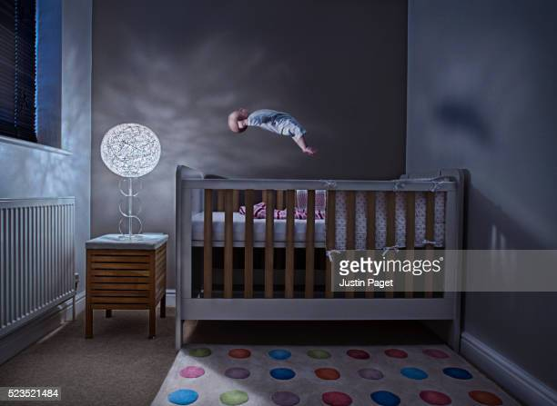 Baby (1-6 months) Levitating above Cot in Bedroom