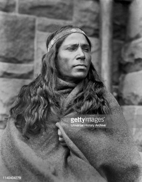 Baby Lone, Kickapoo Medicine Man, Half-Length Portrait Wrapped in Blanket, 1917.