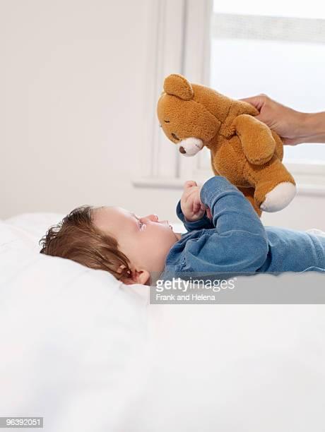 Baby looking at teddy bear