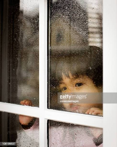 Baby Looking Out from Window