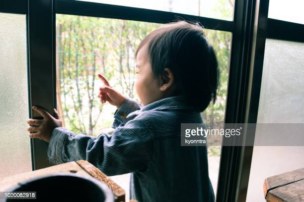 baby looking through window