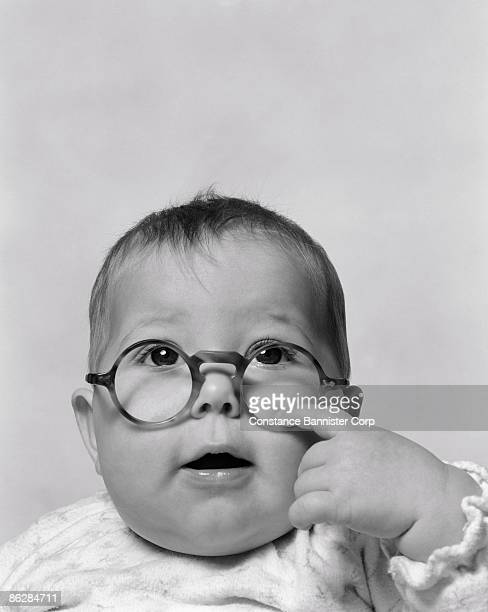 Baby looking up over large eyeglasses
