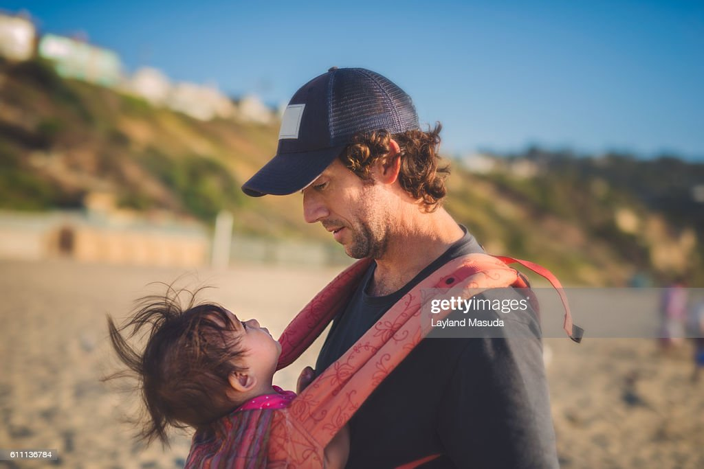 Baby Looks Up To Daddy : Stock Photo