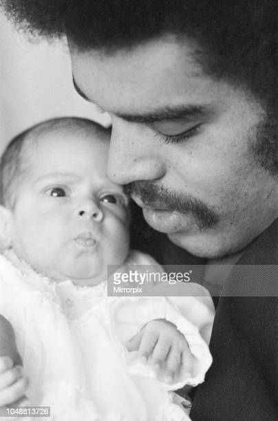 Baby Louise Brown in the safe arms of her father Colin Brown at the home of her maternal grandparents Ray and Myra Balch in Rutland Street Grangetown...