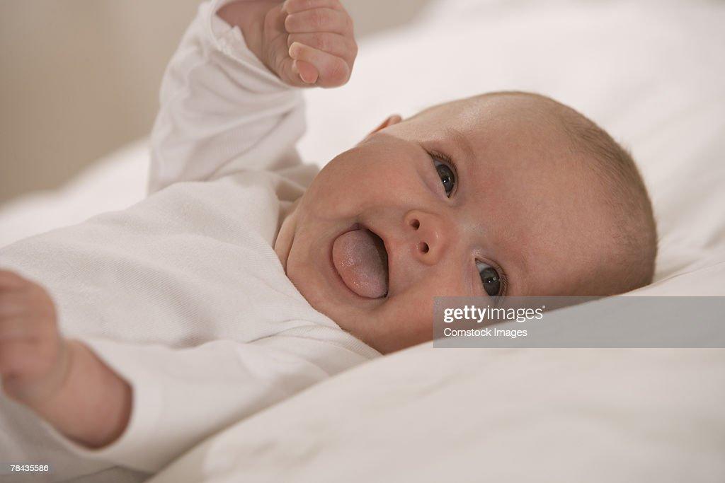Baby lying down : Stockfoto