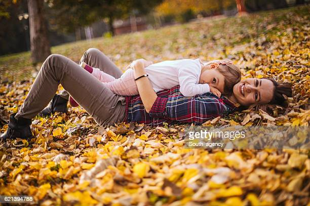 Baby lying on her mother in the park