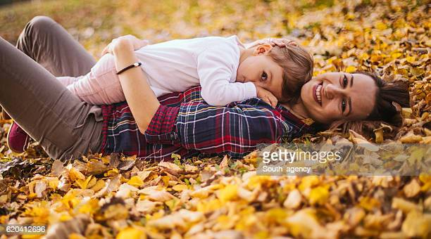 Baby lying on her mother