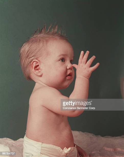 Baby making a funny gesture
