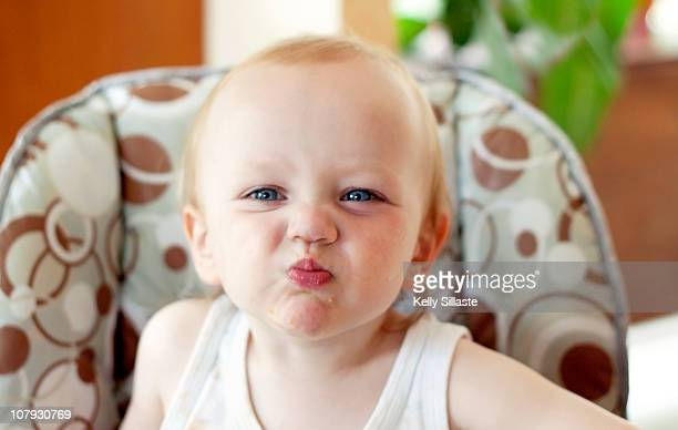 a baby making a silly face after eating - puckering stock pictures, royalty-free photos & images