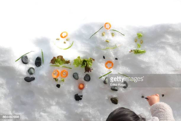 baby making faces on snow - first occurrence stock pictures, royalty-free photos & images