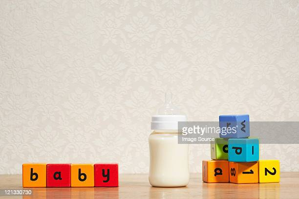 Baby milk and alphabet blocks
