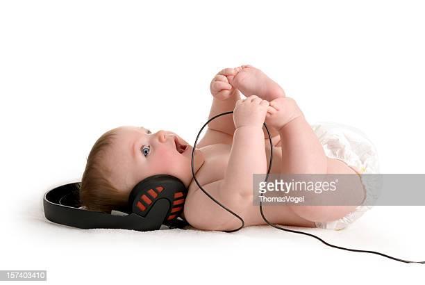 Música infantil. Auriculares audio de niños desnudos del pañal Felicidad