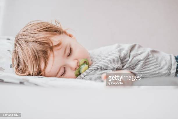 baby needs his sleep! - pacifier stock pictures, royalty-free photos & images