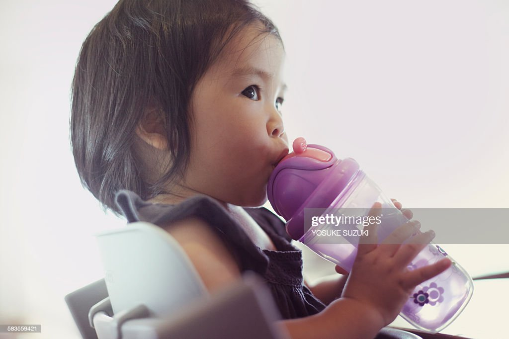 Baby of Asia that are drinking water : Stock Photo