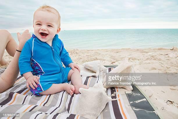 Baby on beach towel