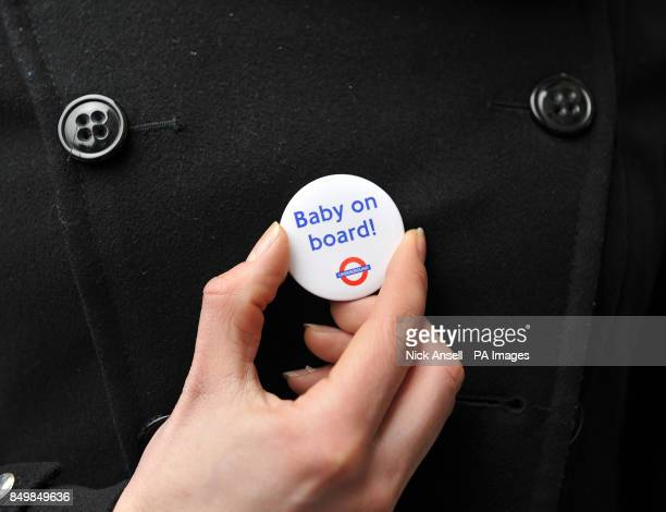 A Baby on Board badge is shown as the Duchess of Cambridge joined Queen Elizabeth II and the Duke of Edinburgh at Baker Street Underground station in...