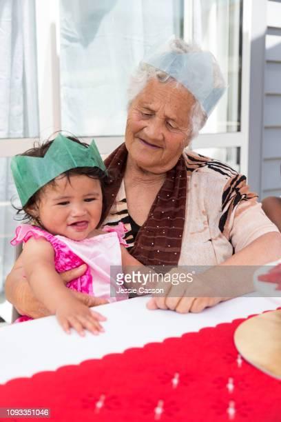 Baby on grandma's lap at Christmas table