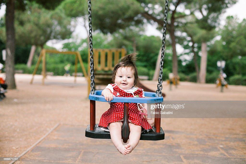 Baby on swing : Stock Photo