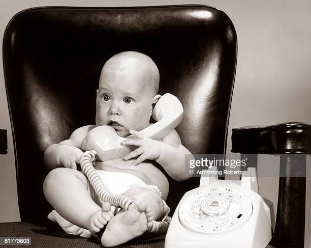Baby on telephone, playing executive businessman.