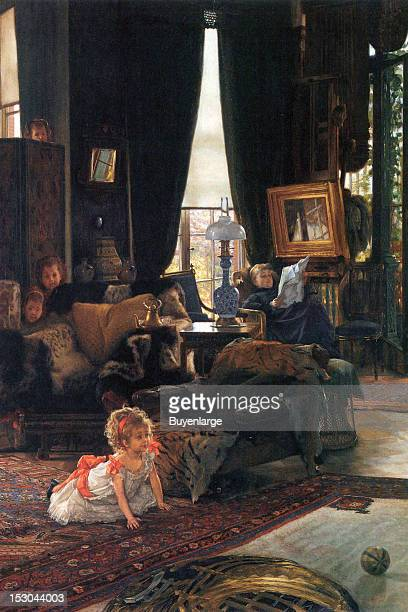 Baby on the floor of a Victorian Living room peers out playing hide seek 1865 By James Tissot