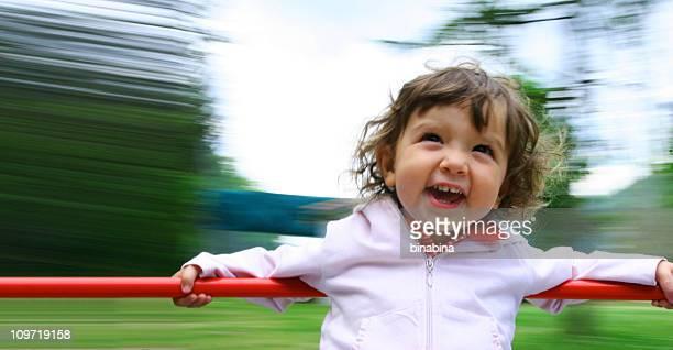 baby on the merry-go-round