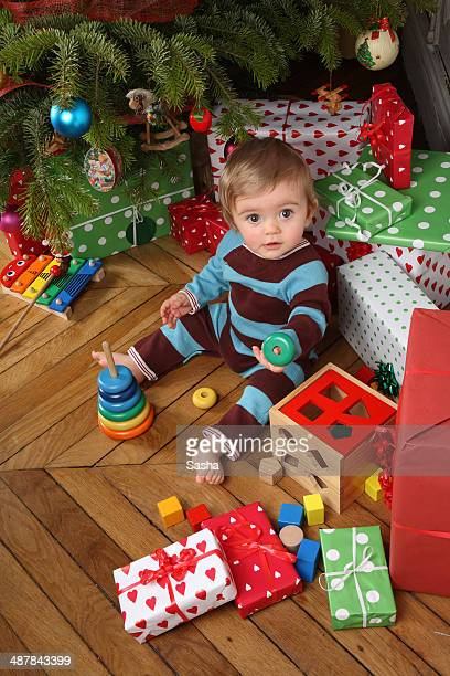 baby oppening his christmas presents