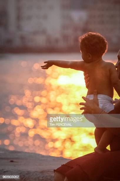 Baby over sunset reflection the Malecon Havana