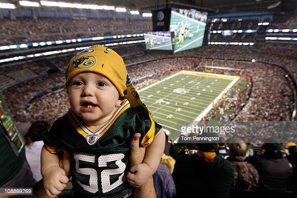 A baby Packers' fan watches the Green Bay Packers take on the Pittsburgh Steelers in Super Bowl XLV at Cowboys Stadium on February 6 2011 in...