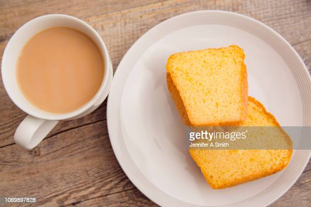 baby panettone and tea - fruitcake stock pictures, royalty-free photos & images