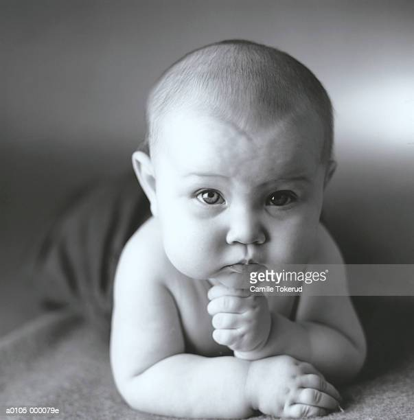 baby - hand on chin stock pictures, royalty-free photos & images